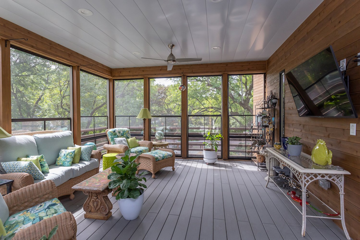 Exterior, Flat RoofLine, House Building Type, Metal Roof Material, Wood Siding Material, and Metal Siding Material The screened porch at the main living level.  The Thomas Residence