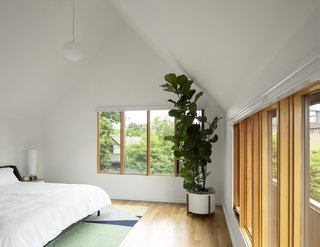 """The third-floor master bedroom at Slender House. """"It's like waking up in the clouds,"""" homeowner Maja Henderson says."""