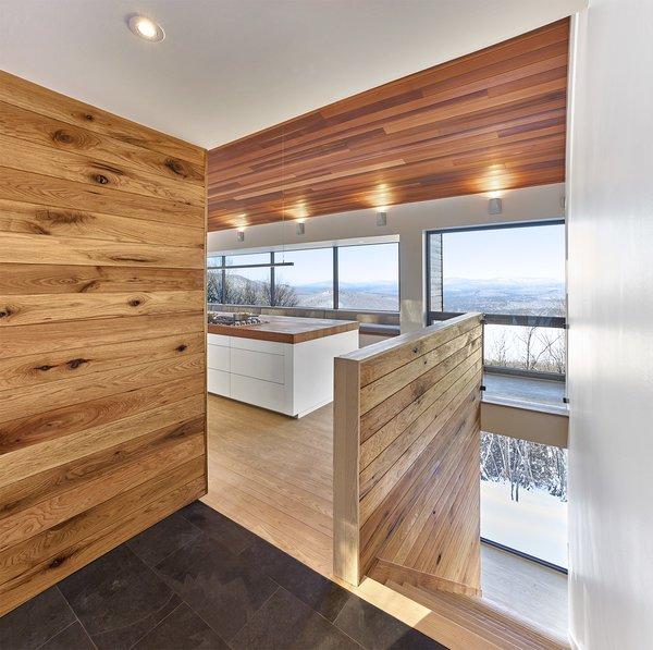 View from entry Tagged: Hallway, Slate Floor, Light Hardwood Floor, and Medium Hardwood Floor.  Laurentian Ski Chalet by RobitailleCurtis
