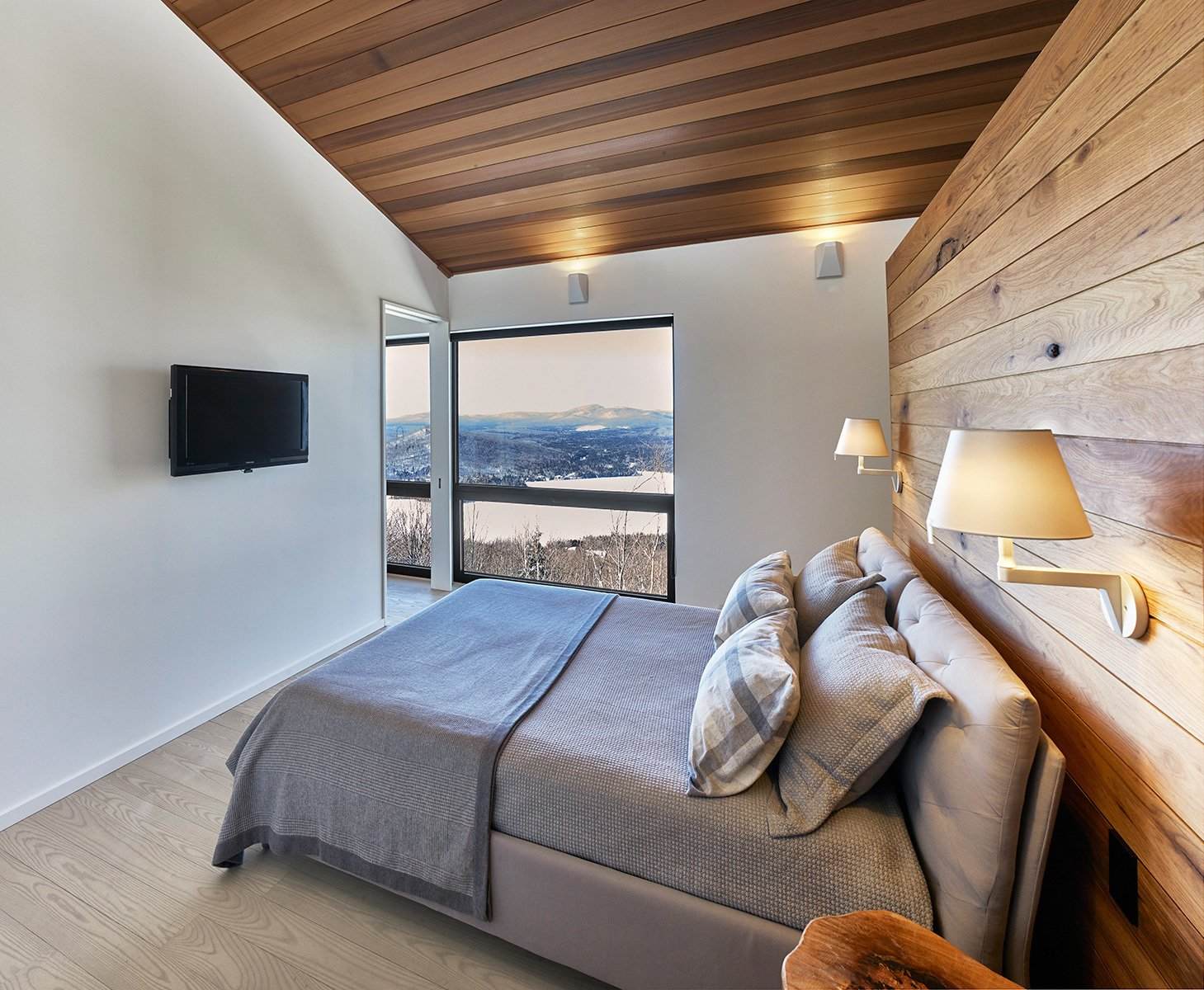 Master Bedroom. Tagged: Bedroom, Night Stands, Bed, Light Hardwood Floor, Storage, Accent Lighting, Wall Lighting, and Medium Hardwood Floor.  Laurentian Ski Chalet by RobitailleCurtis