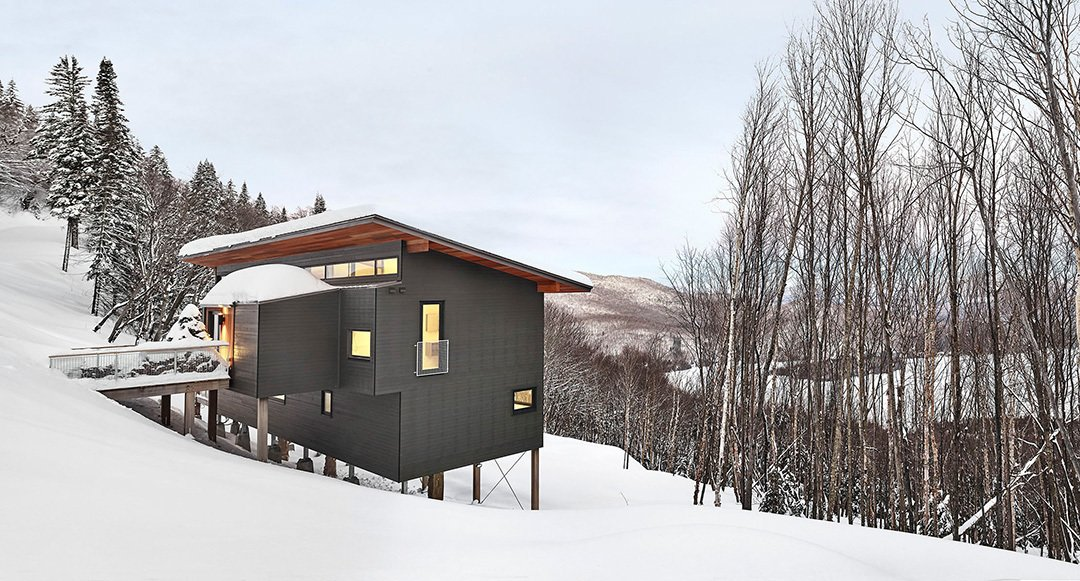 Exterior, Wood Siding Material, Metal Roof Material, House Building Type, Shed RoofLine, and Cabin Building Type View of chalet from entry drive.  Cabins & Hideouts from Laurentian Ski Chalet