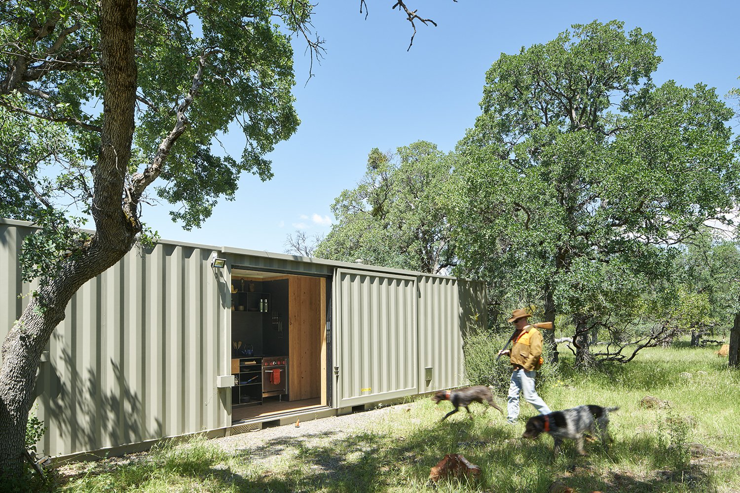 Exterior, Metal Roof Material, Shipping Container Building Type, Metal Siding Material, and Flat RoofLine Architect: Karen Mar, YAMAMAR Design, Location: Manton, California  Container Cabin by YAMAMAR Design