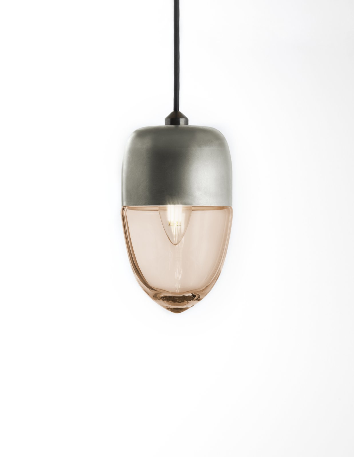 The Vela light has a thin, delicate shape and was designed as small floating vessel for lighting modern spaces. It can be used in multi-pendant installations.  60+ Modern Lighting Solutions by Dwell