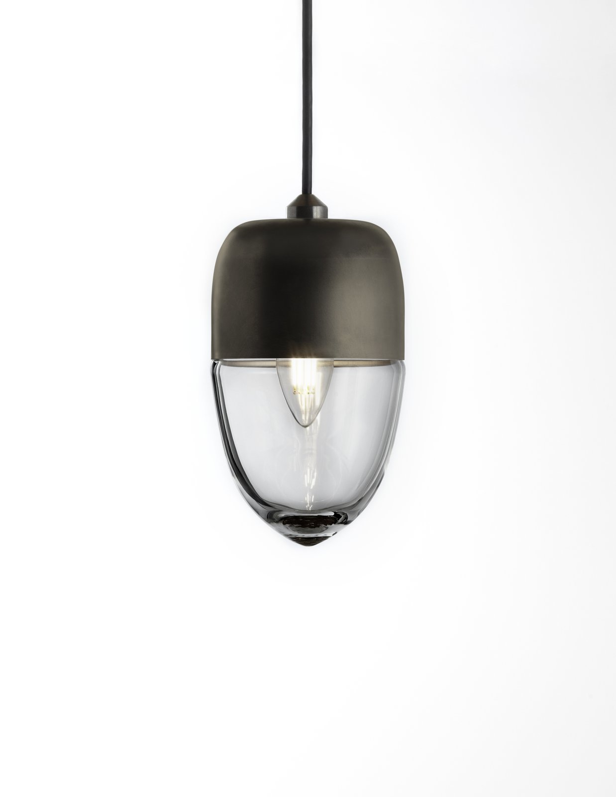 The Vela light has a thin, delicate shape and was designed as small floating vessel for lighting modern spaces. It can be used in multi-pendant installations.  60+ Modern Lighting Solutions by Dwell from Parallel Series