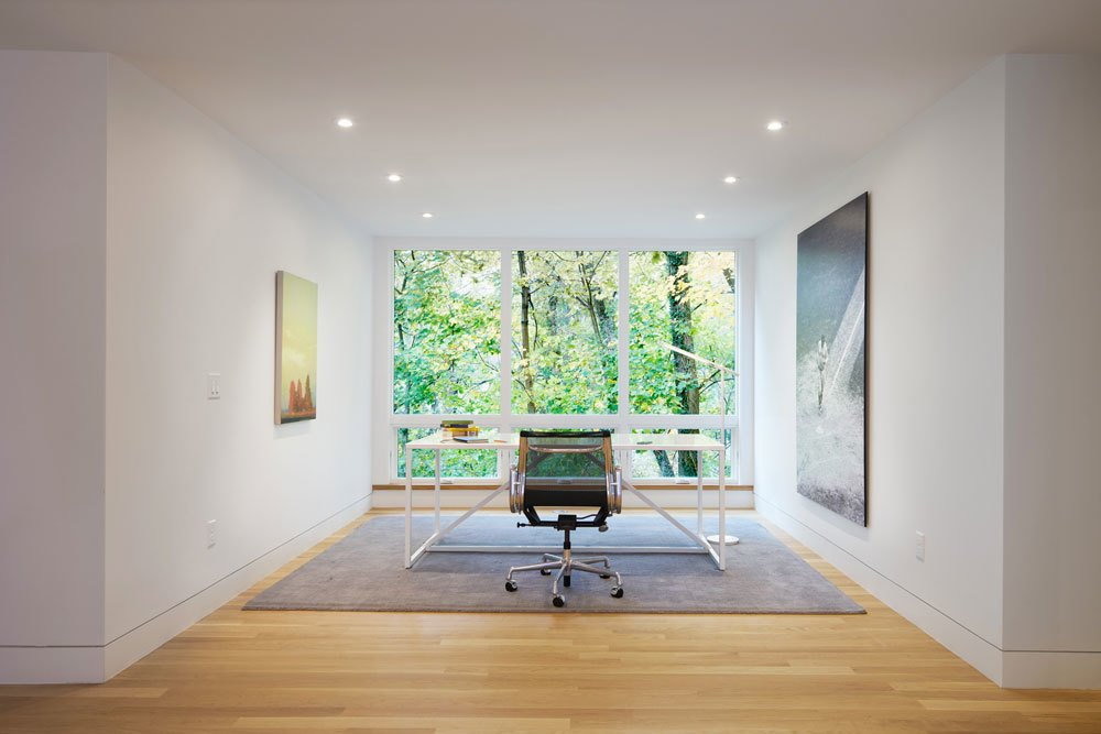 Situated on a sloped-site, each renovated space provides a unique perspective and vista to the dramatic natural surroundings. The office, with its stark modern furnishings and subtle artwork, allows the large window to serve as perhaps the most dramatic, singular frame to the foliage beyond.  Modern Victorian from Beyond The Red Door