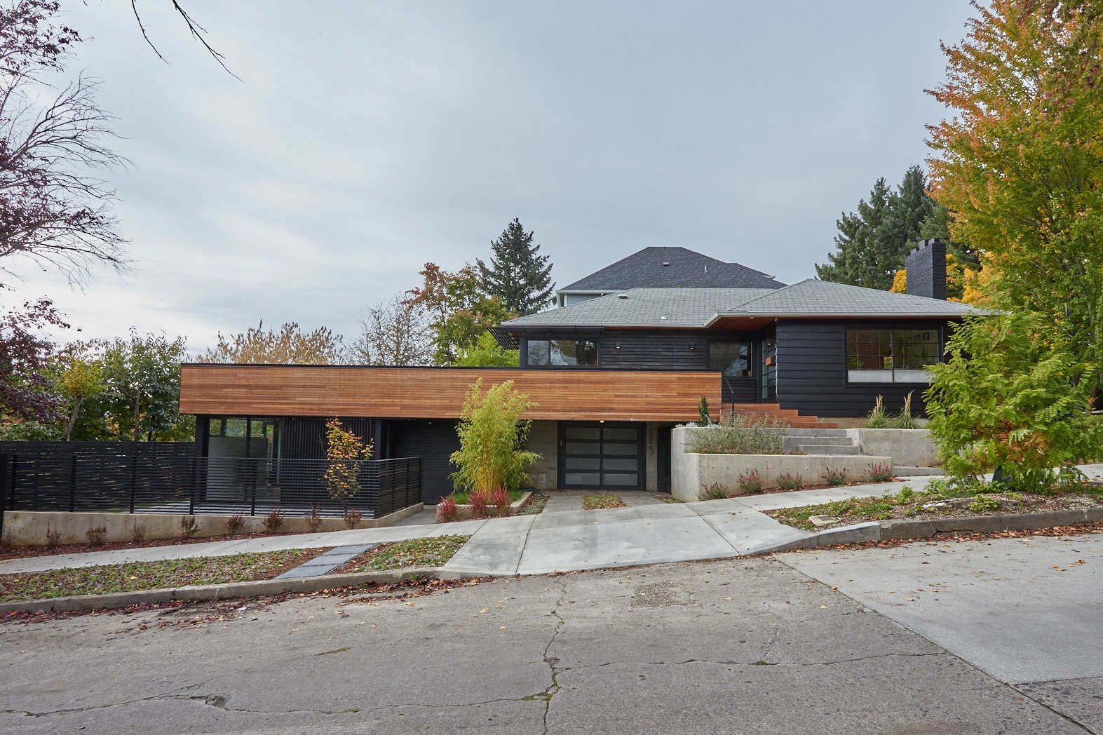 Exterior and House Building Type The sloped corner lot allows the ADU to sit underneath the houses deck.  The Mansfield Frogner House