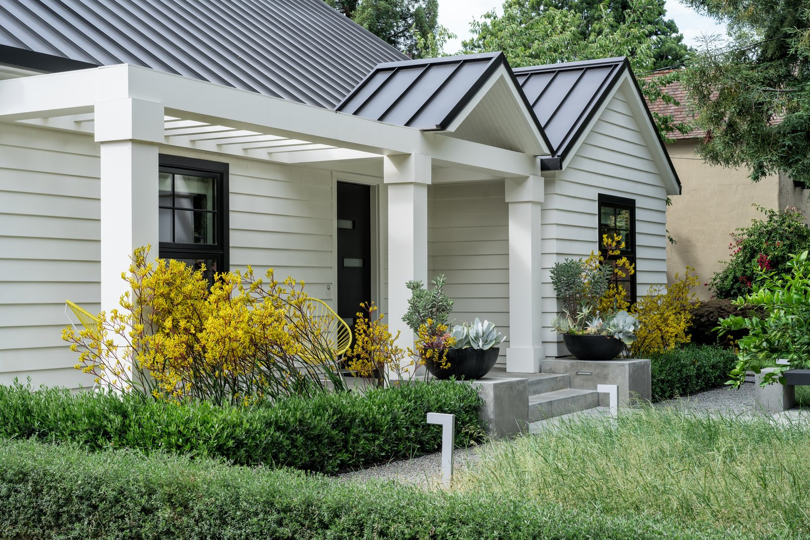 Plantings enhance architectural elements  Refreshing Bungalow by Randy Thueme Design