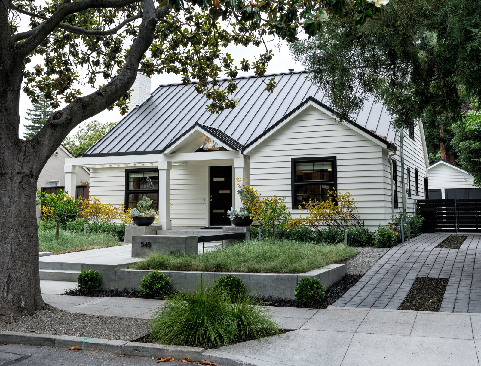 Parking and arrival on a porus paved drive  Refreshing Bungalow by Randy Thueme Design