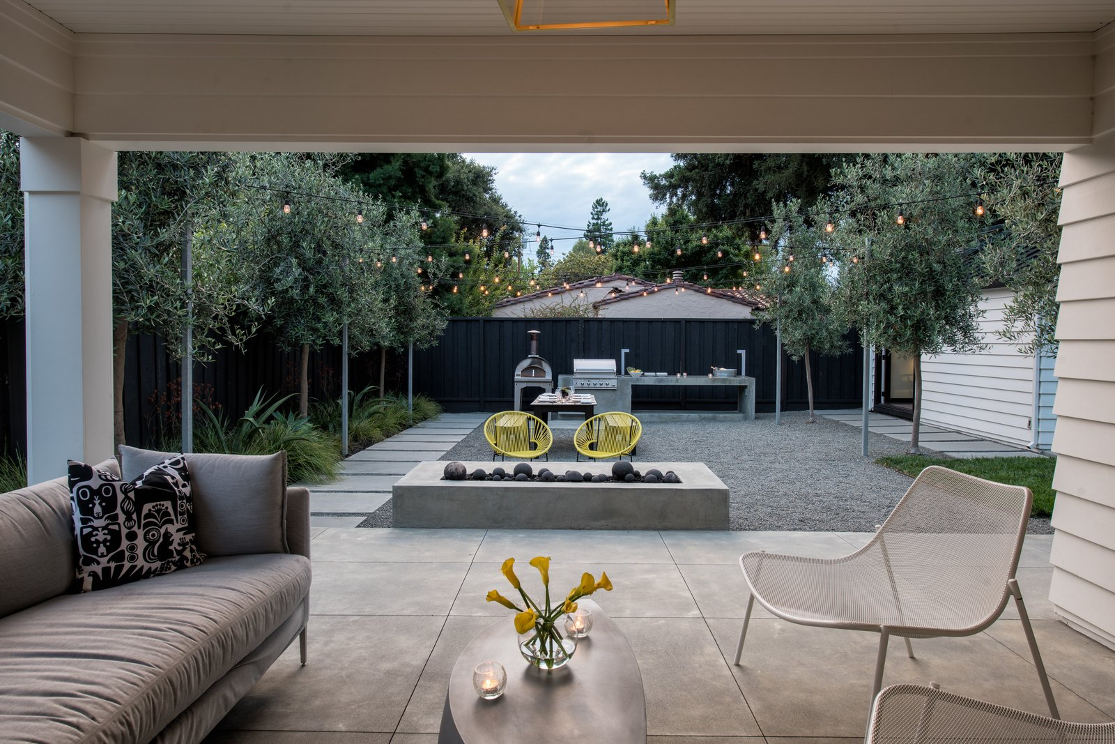 Looking toward the rear yard from a refurbished porch  Refreshing Bungalow by Randy Thueme Design