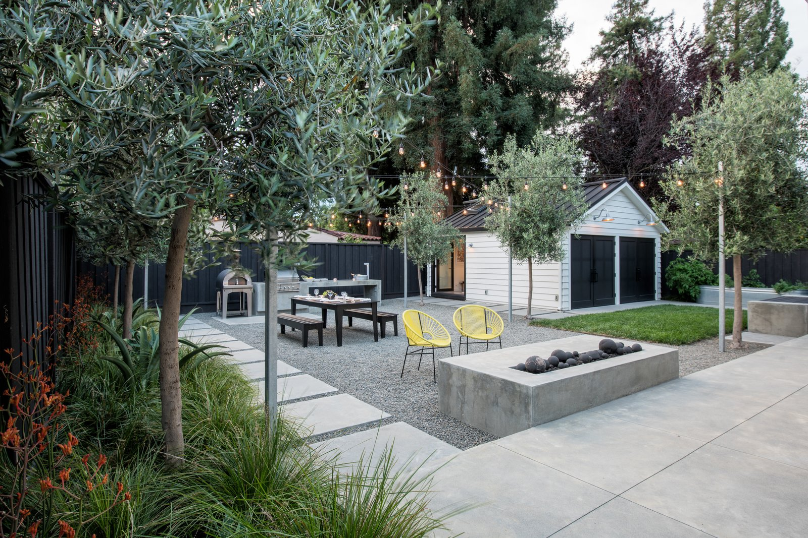 The rear yard is ready for family and friends  Refreshing Bungalow by Randy Thueme Design