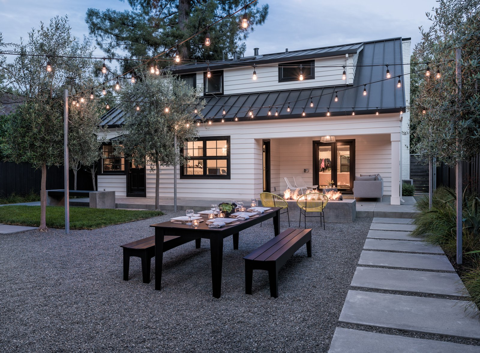 View across the yard at dusk  Refreshing Bungalow by Randy Thueme Design