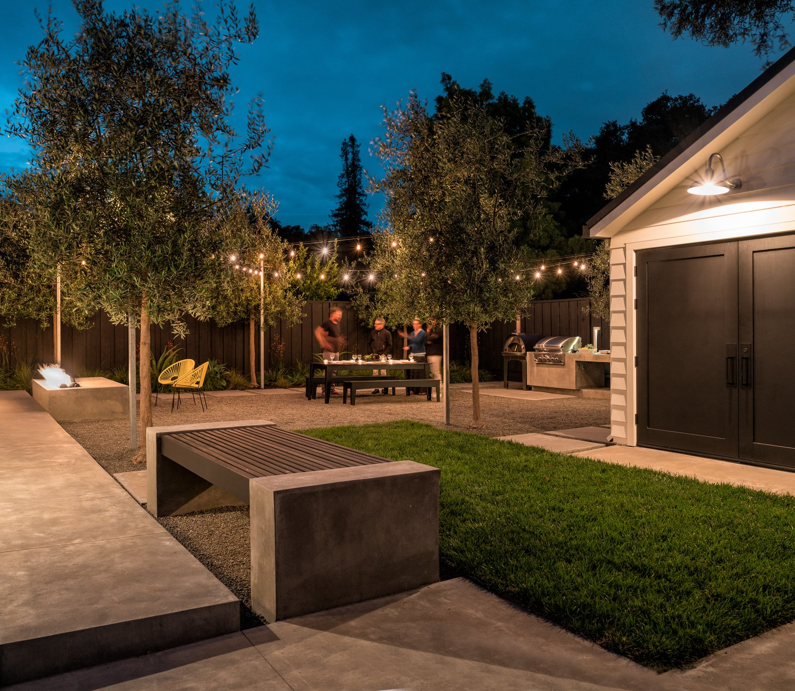 There is room to set up seating for an outdoor movie projected on side wall of the garage  Refreshing Bungalow by Randy Thueme Design