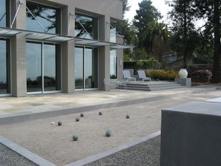 The main terrace is defined on one edge by a bocce court