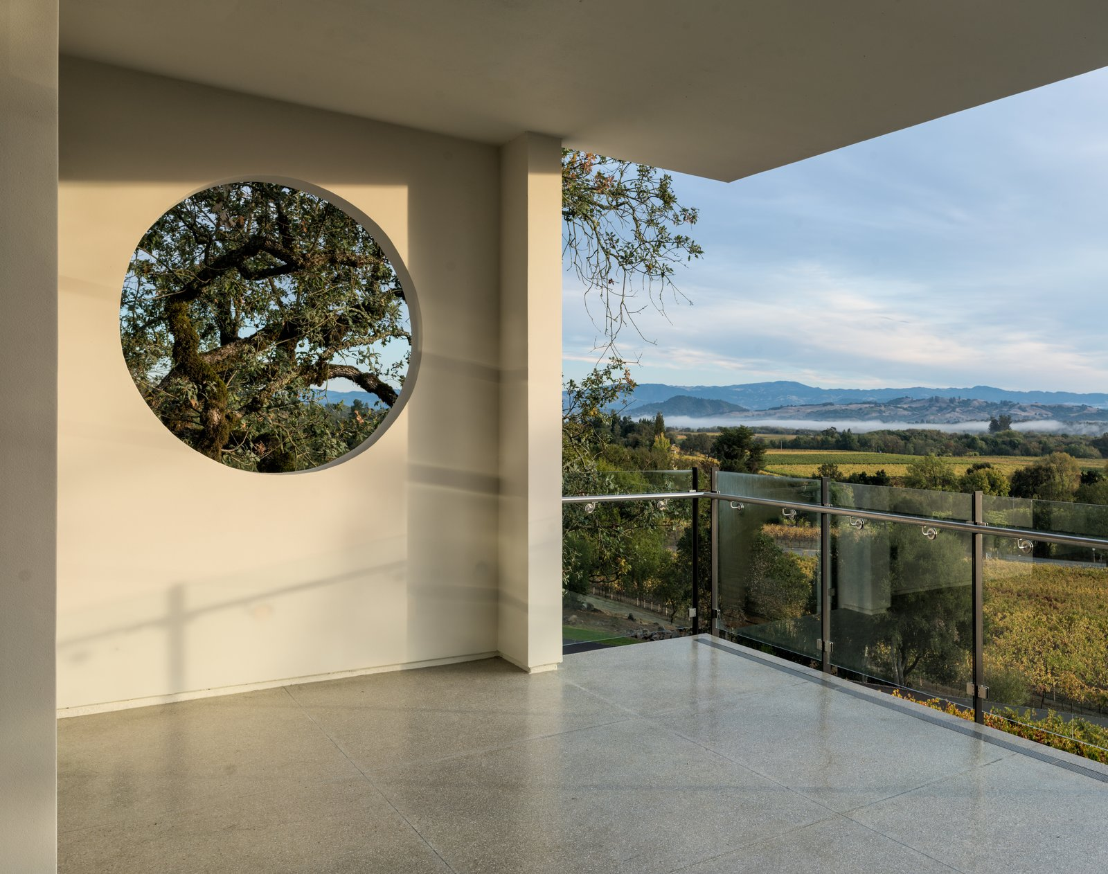 Outdoor, Trees, Hardscapes, and Concrete Patio, Porch, Deck Framed views of the surrounding landscape from main floor level  Hilltop Haven by Randy Thueme Design