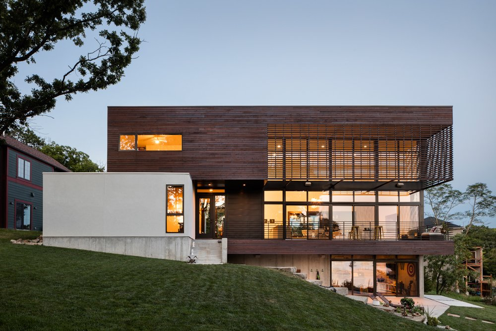 Exterior, Wood Siding Material, Stucco Siding Material, House Building Type, and Flat RoofLine Modern Lodge, exterior - The design approach of the site is to connect the house to the land  Modern Lodge