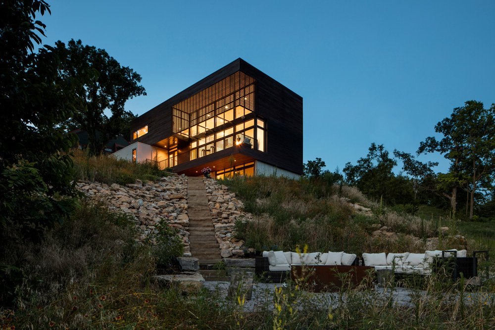 Exterior, House Building Type, Cabin Building Type, and Flat RoofLine Modern Lodge in the evening  Modern Lodge