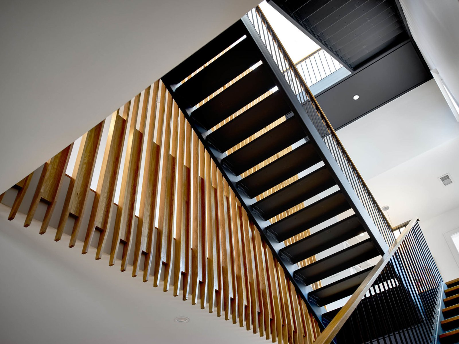 Staircase, Metal Tread, Wood Tread, Metal Railing, and Wood Railing Stair screen  The Historic Ely Building