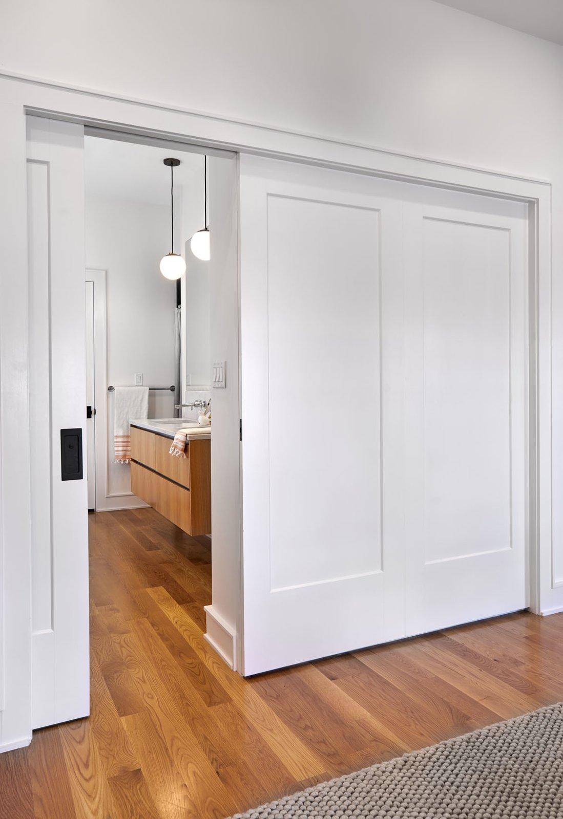 Doors, Interior, Wood, and Sliding Door Type Master Bathroom  The Historic Ely Building
