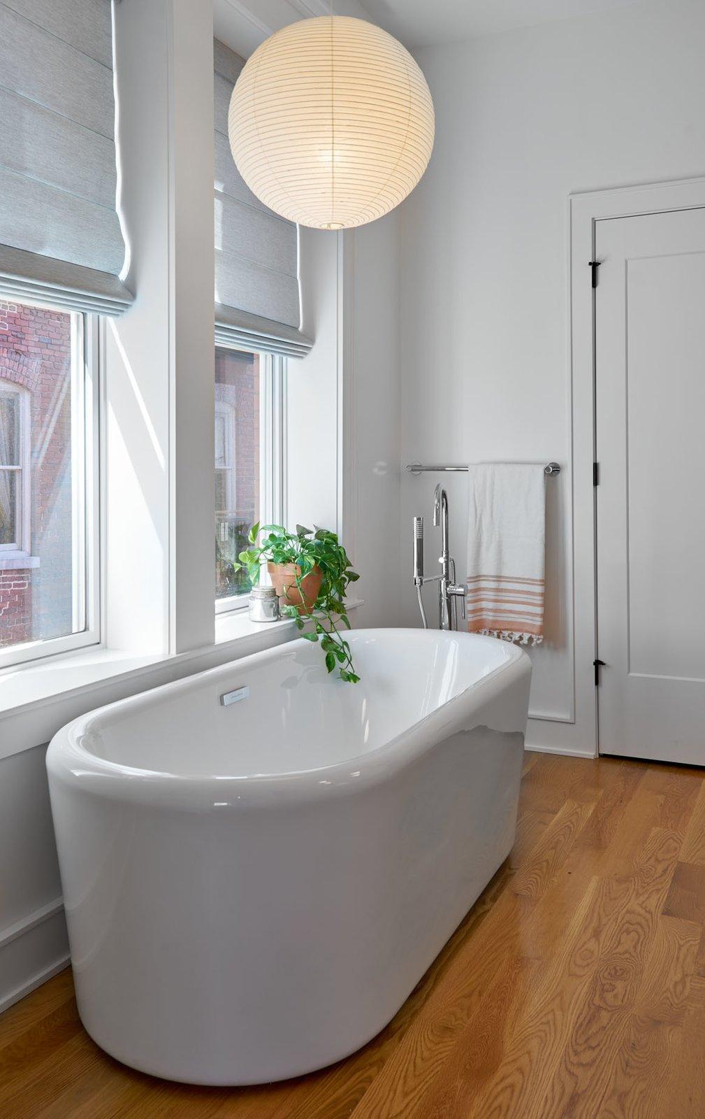 Bath Room, Freestanding Tub, and Pendant Lighting Master Bathroom  The Historic Ely Building