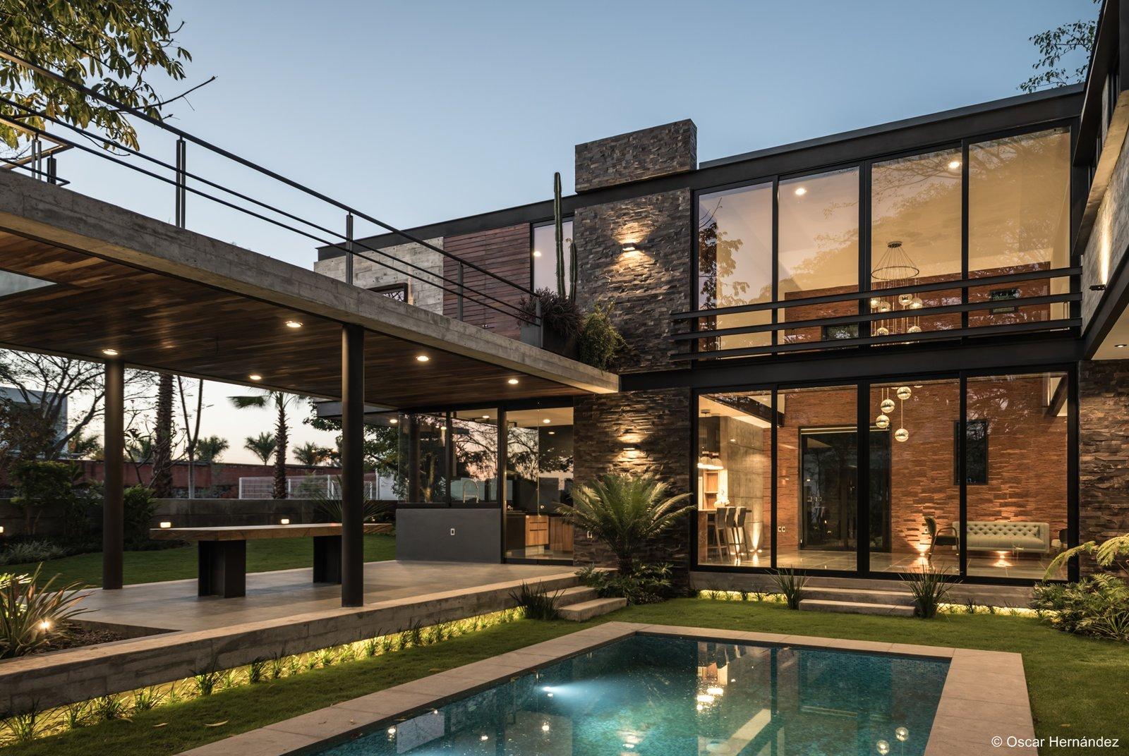 The interior patio  Casa Kalyvas by Taller de Arquitectura
