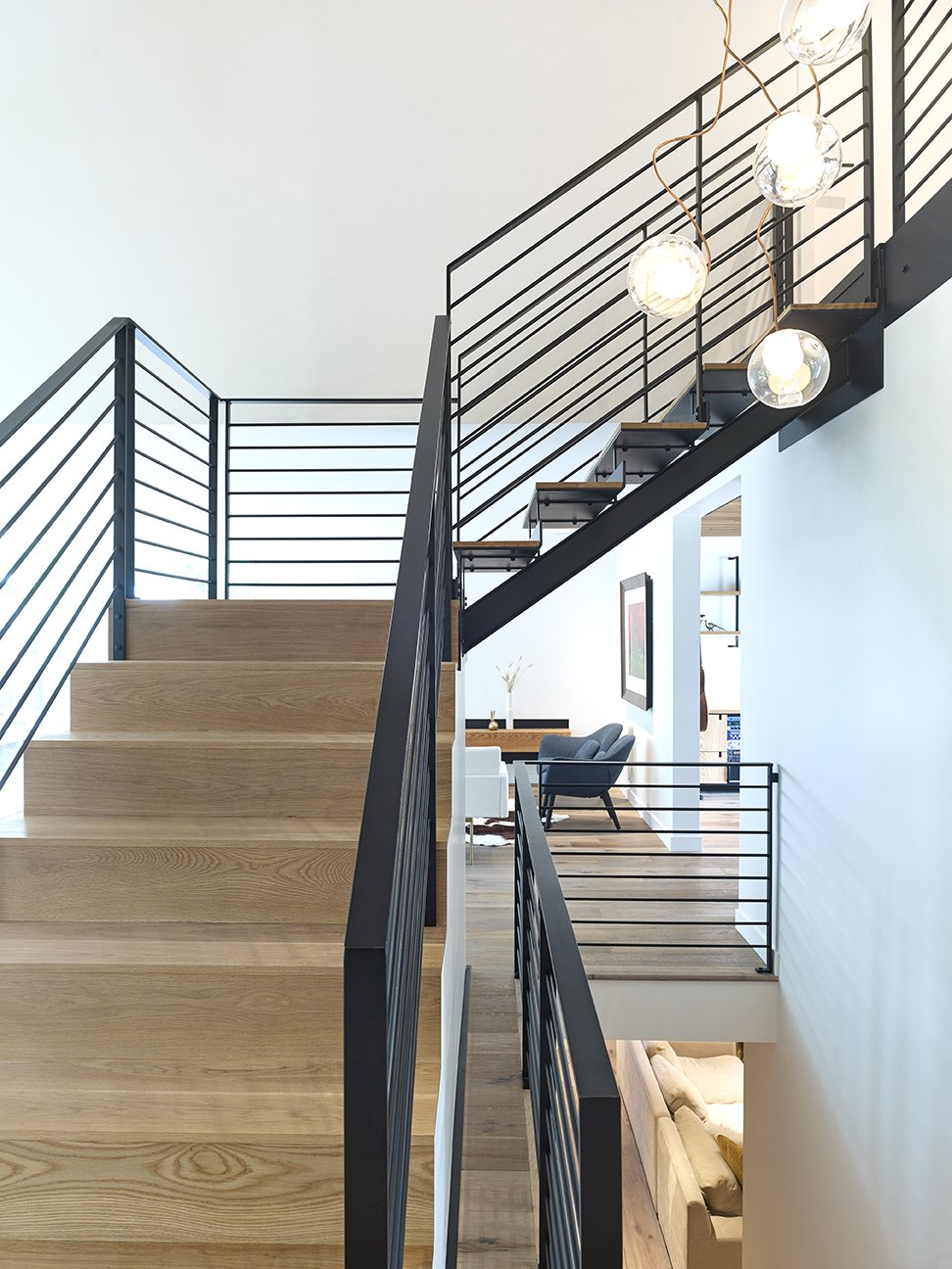 Staircase, Wood Tread, and Metal Railing Feature Stair  Crestwood Re-Model by Mindy Gudzinski Design