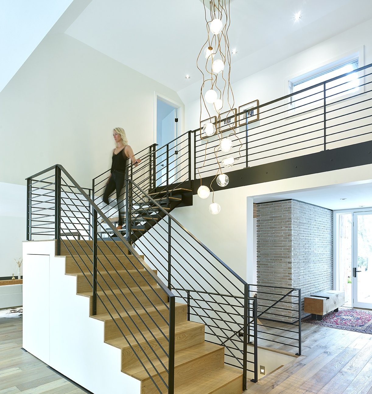 Staircase, Wood Tread, and Metal Railing Feature Stair after re-model  Crestwood Re-Model by Mindy Gudzinski Design