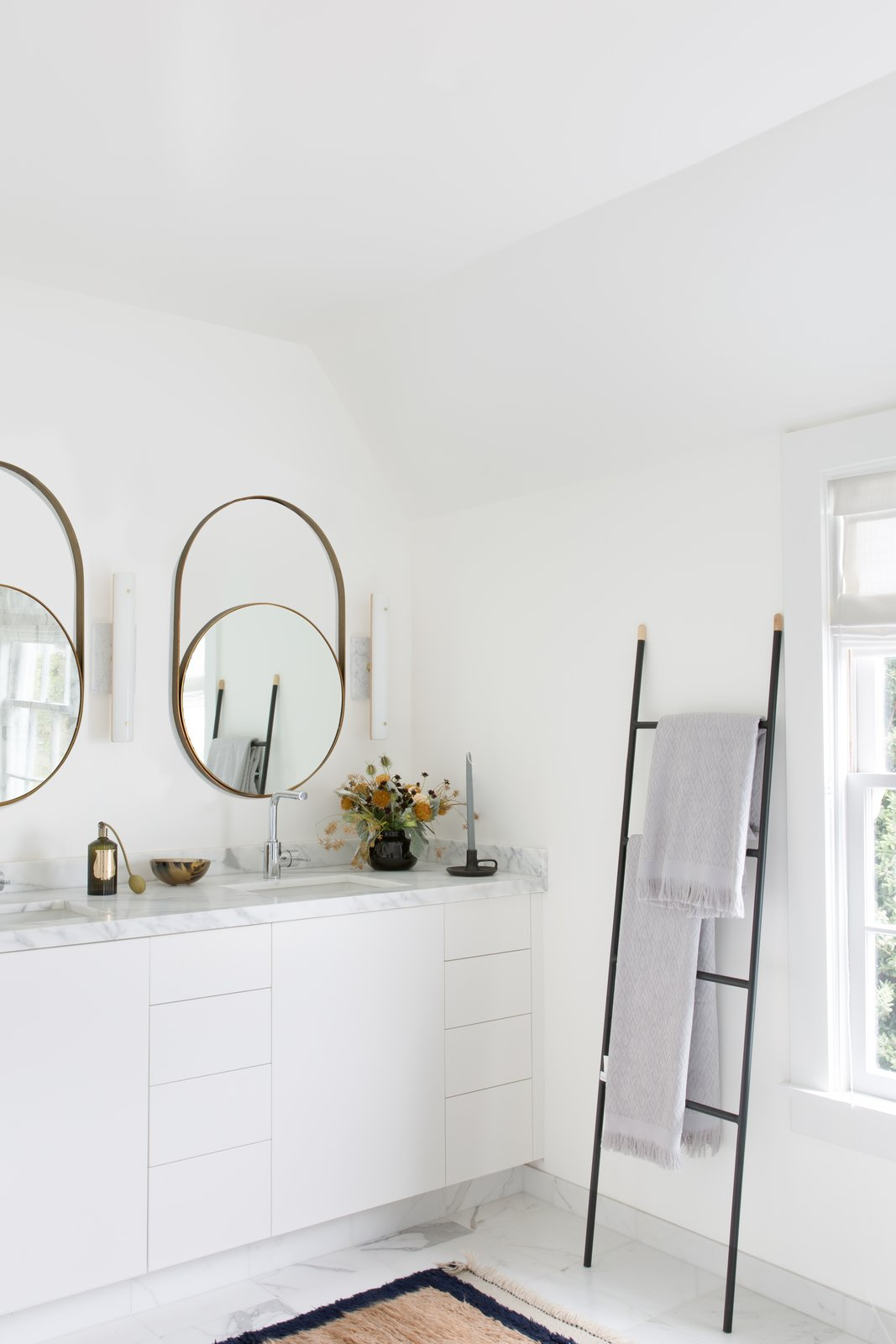 Bath, Undermount, Wall, Light Hardwood, Marble, and Marble Master bathroom with modern round mirrors and towel ladder.  Bath Light Hardwood Marble Undermount Marble Wall Photos from Sea Cliff Preppy Contemporary