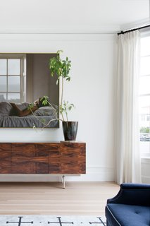 Dark wood credenza in living room.