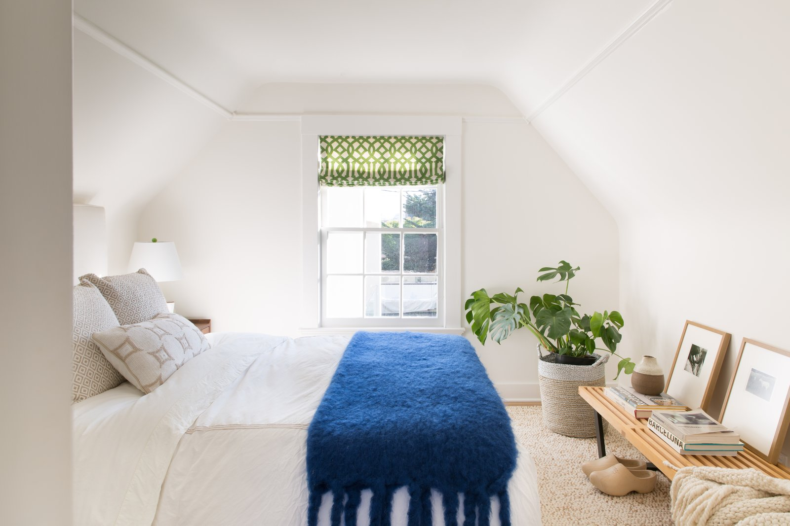 Bedroom, Bed, Lamps, Table, Light Hardwood, Bench, and Night Stands Guest bedroom with white bedding and bright blue throw.  Best Bedroom Light Hardwood Lamps Table Photos from Sea Cliff Preppy Contemporary