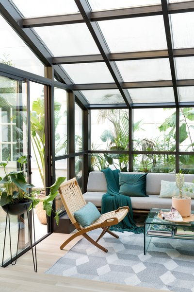 Sunroom with Modernica sofa and folding Wegner chair.