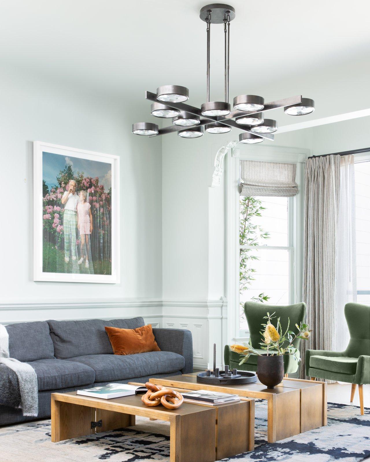 Living Room, Rug Floor, Pendant Lighting, Sofa, Light Hardwood Floor, Chair, Ceiling Lighting, and Coffee Tables Living Room  Moody Mission Victorian by Regan Baker Design