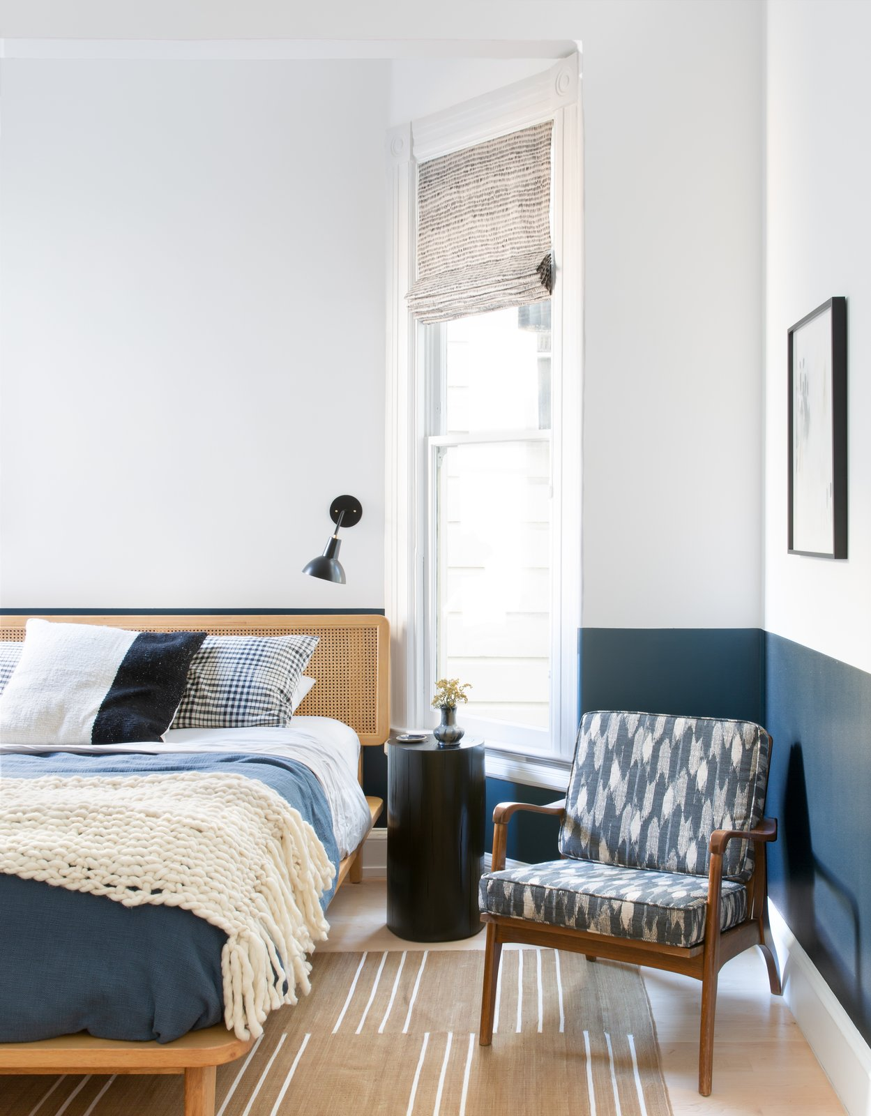 Bedroom, Chair, Wall Lighting, Lamps, Night Stands, Rug Floor, Bed, and Light Hardwood Floor Guest Room  Moody Mission Victorian by Regan Baker Design