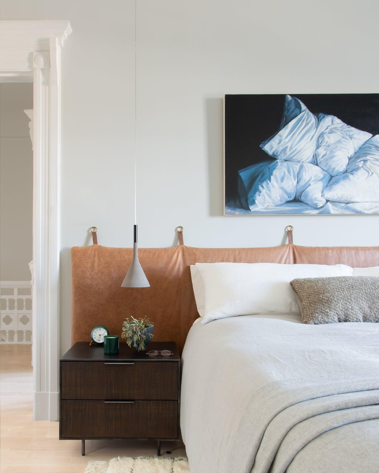 Bedroom, Bed, Rug Floor, Pendant Lighting, Light Hardwood Floor, Night Stands, and Accent Lighting Master Bedroom  Moody Mission Victorian by Regan Baker Design