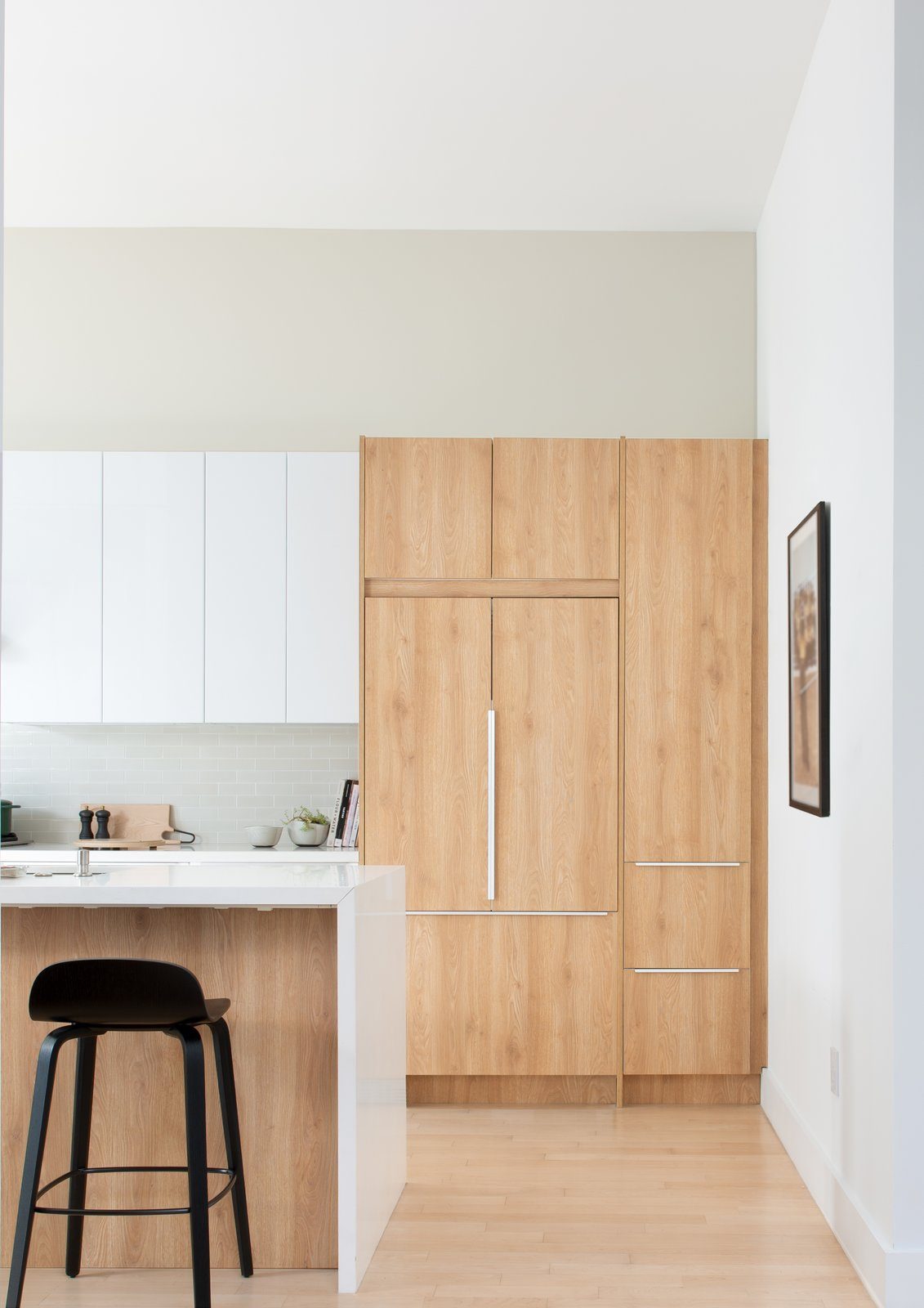 Kitchen, Ceiling Lighting, White Cabinet, Laminate Cabinet, Refrigerator, Subway Tile Backsplashe, Light Hardwood Floor, and Wood Cabinet Kitchen  Moody Mission Victorian by Regan Baker Design
