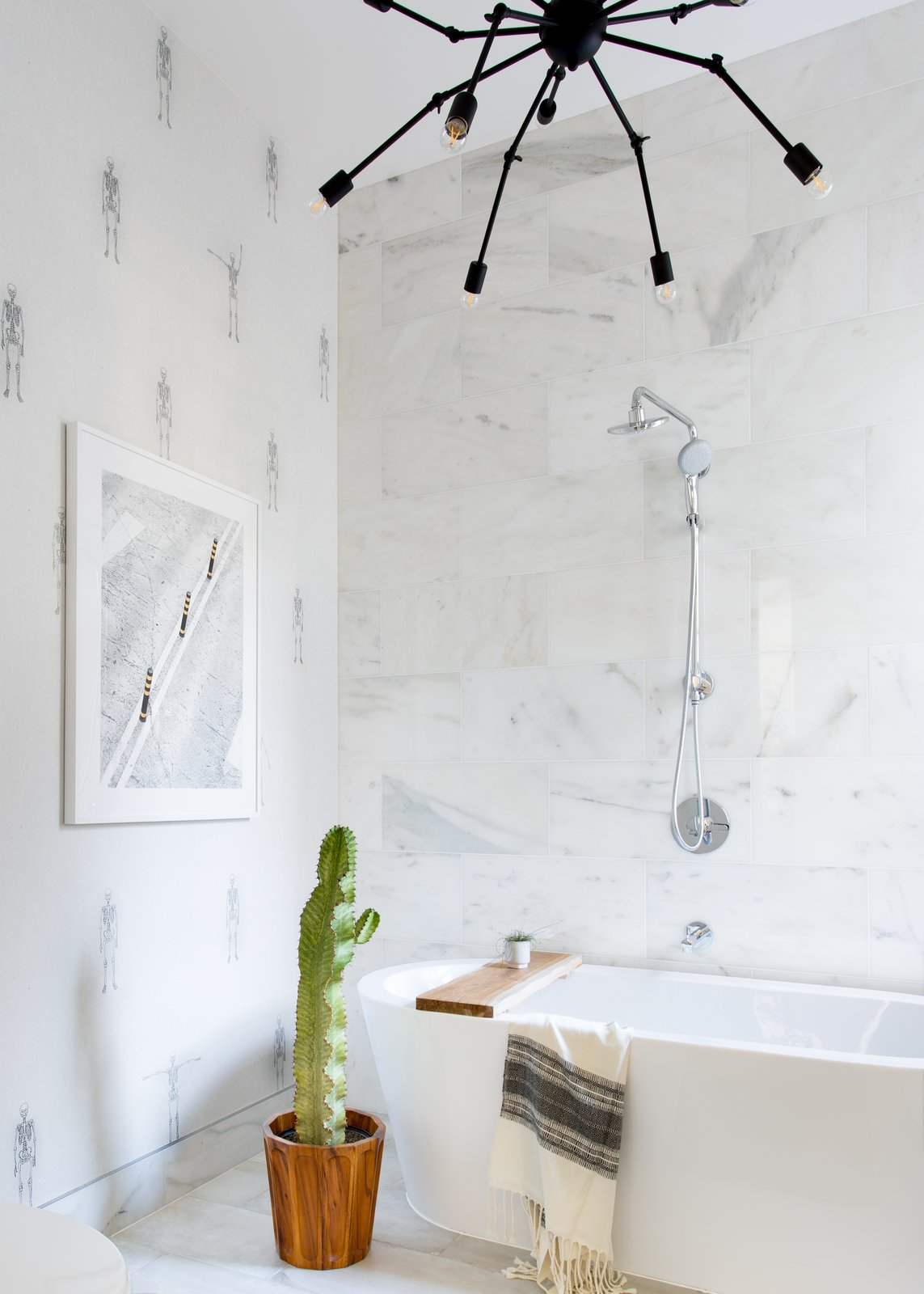 Bath Room, Marble Floor, Freestanding Tub, Pendant Lighting, Marble Wall, Stone Tile Wall, and Accent Lighting Master Bath  Moody Mission Victorian by Regan Baker Design