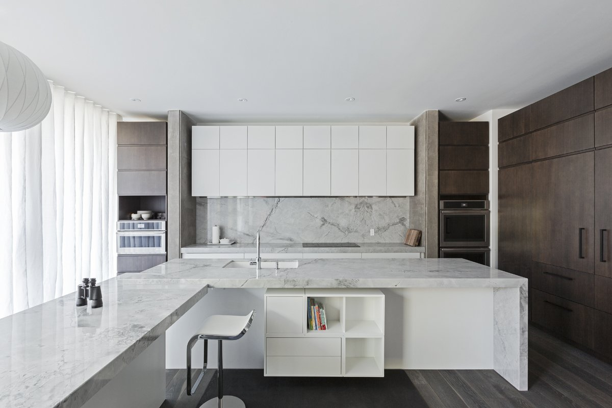 kitchen Tagged: Kitchen, Wall Oven, Range, Marble Counter, Wood Cabinet, Marble Backsplashe, Pendant Lighting, Recessed Lighting, and Drop In Sink.  Opposite House by rzlbd