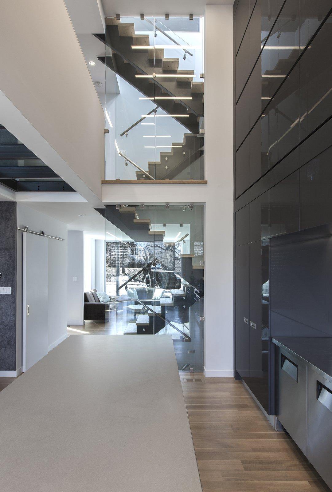 kitchen - stairwell  Instar House by rzlbd