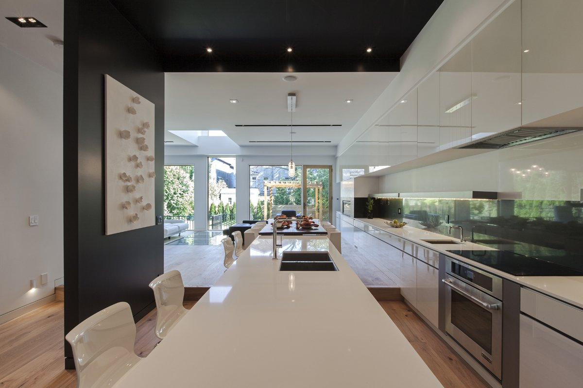 main floor 50' long millwork, looking toward the living room  Tetris House by rzlbd