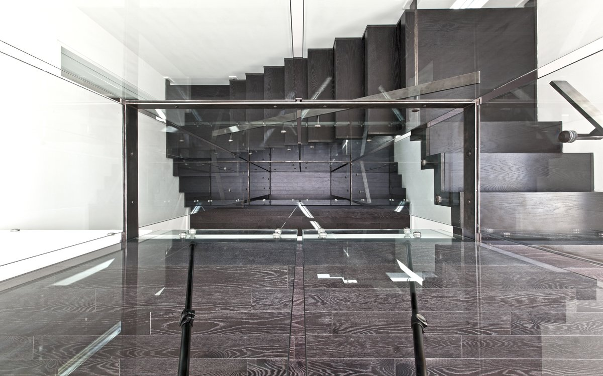 staircase & lightwell  Patio House by rzlbd