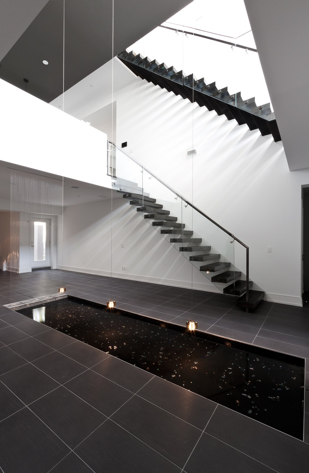 central void, staircase, reflection pool  5/6 House by rzlbd