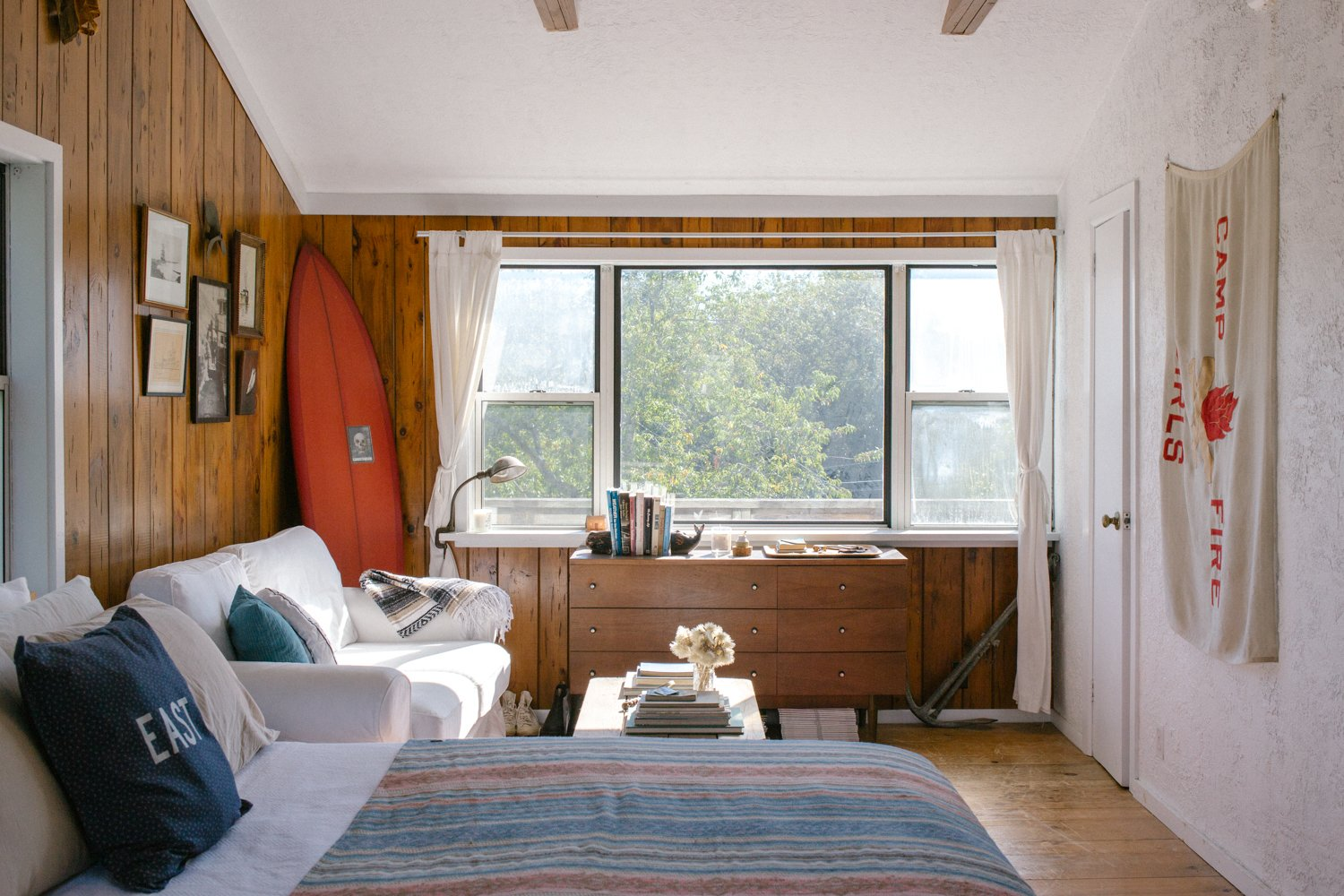 Bedroom, Chair, Medium Hardwood Floor, Bed, Dresser, and Table Lighting Mikey DeTemple's home serves as the perfect Montauk surf shack.  Photo 6 of 7 in At Home with Mikey DeTemple