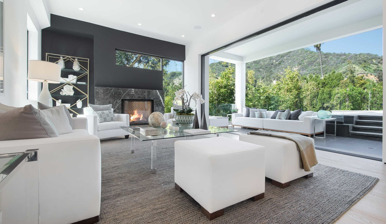 Sliding walls of glass reveal rolling canyons beyond the swimming pool and entertaining areas and create a seamless flow between indoor and outdoor living spaces.  Cherokee Contemporary