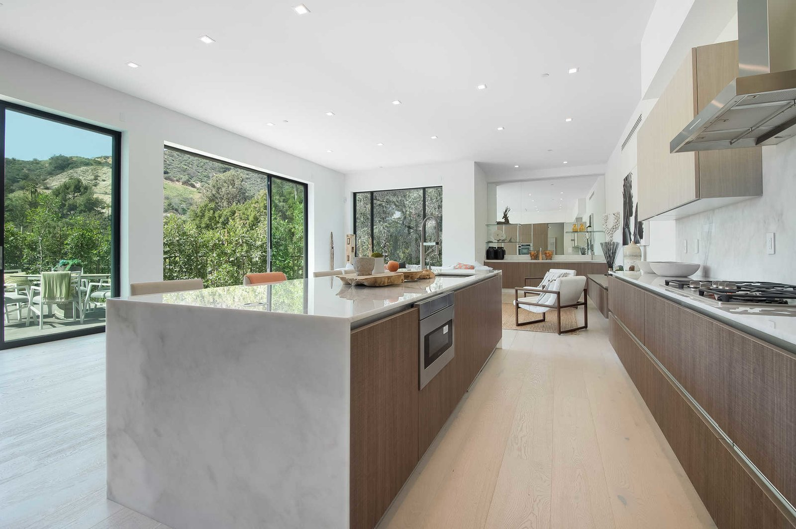 The gourmet Italian kitchen is complete with Miele appliances, a butler's pantry, eat-in island and Carrara marble countertops.  Cherokee Contemporary