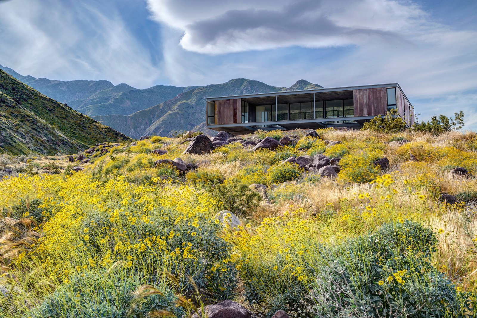 The Beadle House appears to float above the landscape, set upon a pedestal-like foundation.  Desert Palisades Chino Canyon
