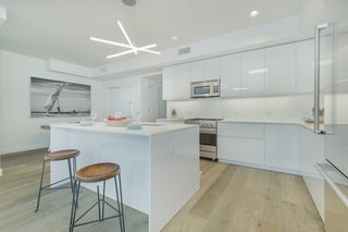 Open kitchens feature German-made Leicht cabinetry, Caesarstone countertops, wide-plank French, white oak flooring, Viking Professional and LG Smart Technology appliances.