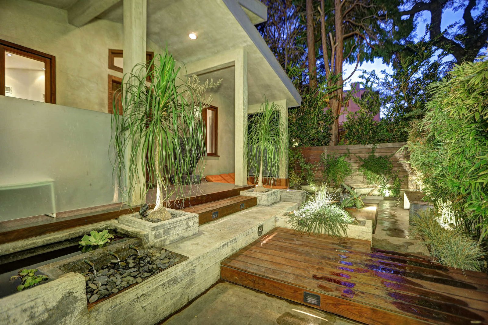 A serene Koi water garden provides a moment of quietude before entering the main residence.  Sleek West Hollywood Contemporary