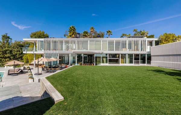 Laden with a series of custom-designed, Swisspearl cement board panels and geometric louvres, glass-enclosed living spaces are shielded from the sun while taking full advantage of natural light and available views.