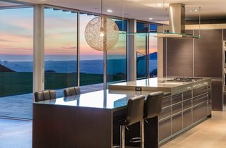 The custom-fabricated, Italian Del Tongo chef's kitchen looks onto the sweeping cityscape.