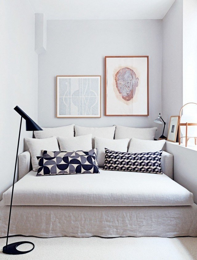 Patterned throw pillows paired with a neutral sofa creates a soothing palette in a tight space.  Photo 4 of 11 in 10 Effective Tips For Making the Most Out of Small Space Interiors