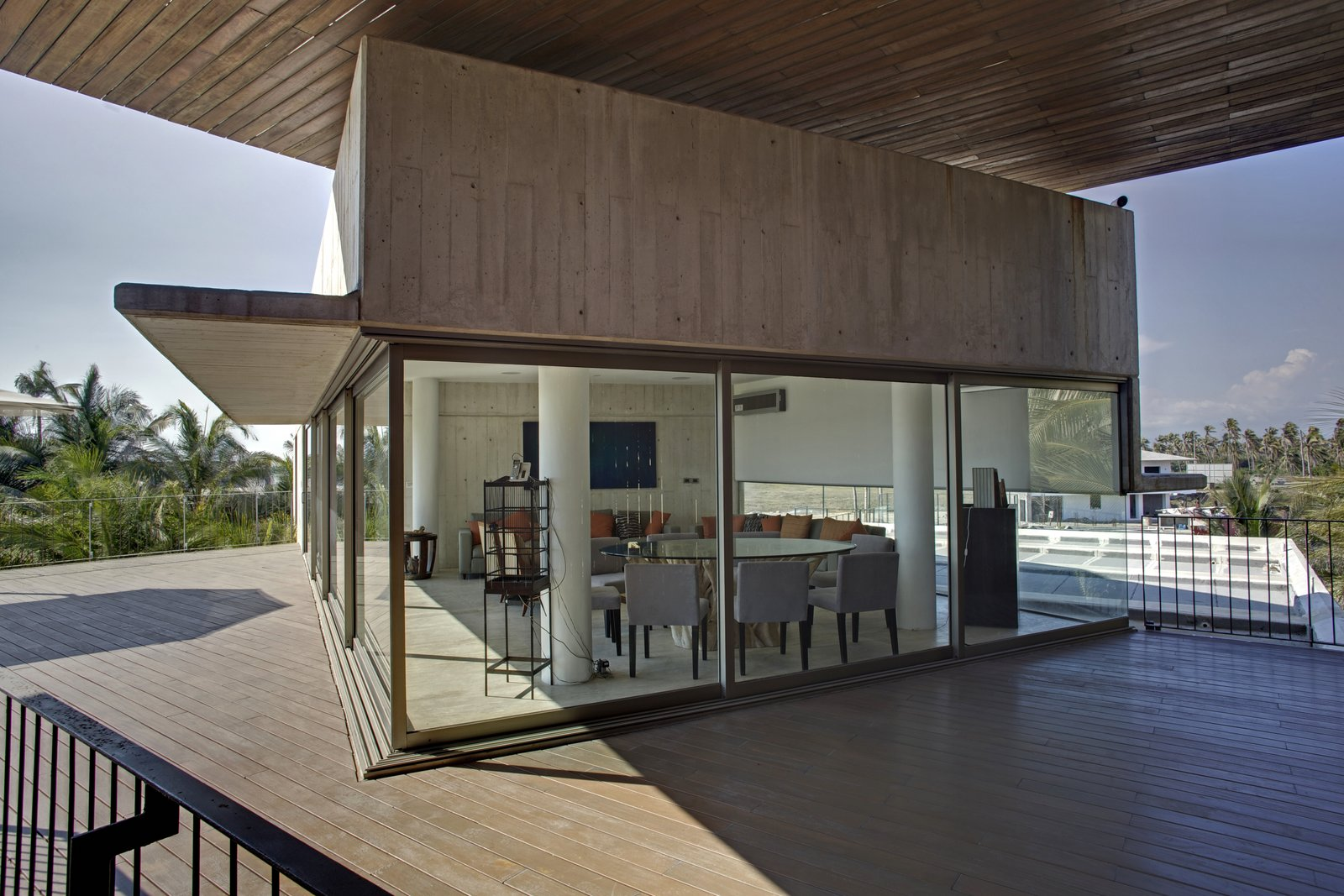 Living Room and Travertine Floor Terrace Level 3  La Caracola Beach House by PAUL CREMOUX studio